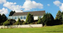 Strathardle is a large detached 3-bedroom bungalow standing in an elevated position with superb sea and mountain views.