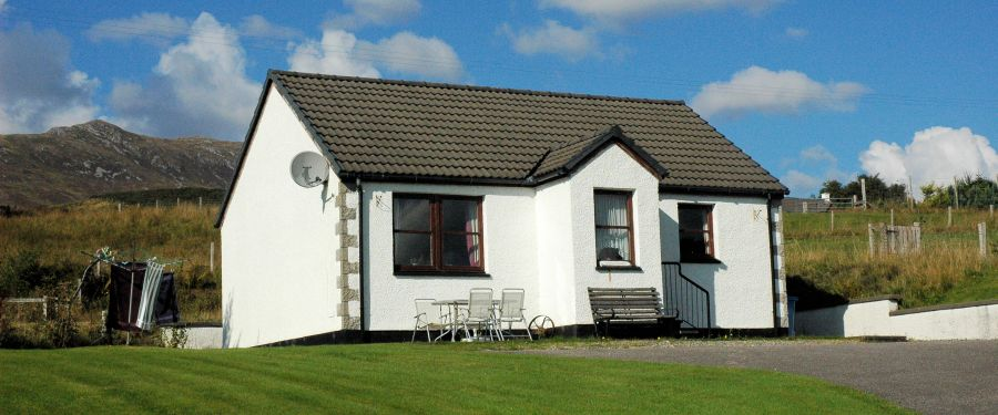 Tarlogie is a 2-bedroom detached holiday bungalow in elevated position with magnificent sea and mountain views.