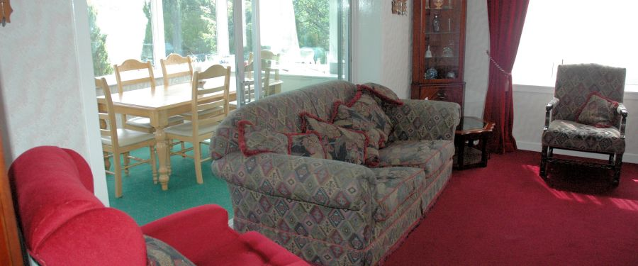There is a large, spacious and comfortable lounge with doors leading in to the conservatory.