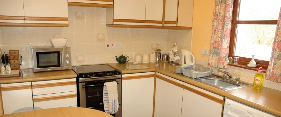 There is a well equipped kitchen in Tarlogie with a dining table and excellent views from the window.